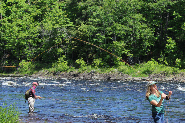 Cheryl Daigle (right) and Hazen Dauphinee fish for shad on June 10 in the Penobscot River in Old Town.