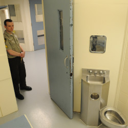 Penobscot County Corrections officer Sgt. Chris Wilson stands near the door of a empty cell at the Penobscot County Jail, July 2, 2013.