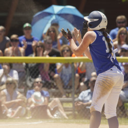 Stearns player Peighton Ingersoll (18) stirs up the home fans during the state championship game against Richmond at Coffin Field in Brewer on Saturday.