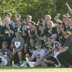 The Old Town baseball team and softball  team pose together for a picture at Coffin Field in Brewer on Saturday after both squads won state championships.