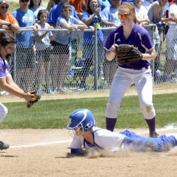 Bucksport third baseman Julia Zavalza (left) gets ready to put the tag on Madison High School's Madeline Wood after the Bucks caught Wood in a rundown during the Class C softball championship at St. Joseph's College in Standish on Saturday.