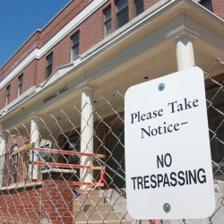 "A ""No Trespassing"" sign can be seen on Wednesday near Kimball Hall at the University of Maine at Machias in Machias. Kimball Hall will be torn down."