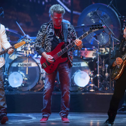 Journey's Jonathan Cain (from left), Ross Valory and Neal Schon perform during their show on Wednesday at the Darling's Waterfront Pavilion in Bangor.