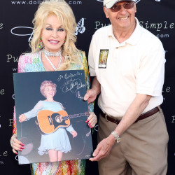 Bangor resident and businessman Orlando Frati meets country music star Dolly Parton backstage before her performance at Darling's Waterfront Pavilion on Saturday, June 18. Frati last saw Parton, and snapped the photo he is carrying here, 47 years ago when she was the relatively unknown opening act for country star Porter Wagoner at a performance in Bangor.