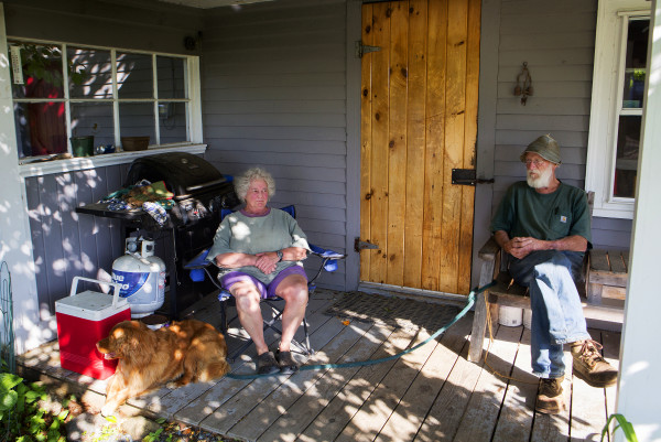 Cynthia Thayer (left) and Bill Thayer relax on their porch at Darthia Farm in Gouldsboro on Tuesday.