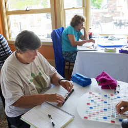 Cheryl Melvin (center) contemplates her next word during a women's Scrabble tournament at Markel's Bakehouse in Castine Tuesday. The competition brought 16 high-level players from across the country to Castine for a three-day tournament.