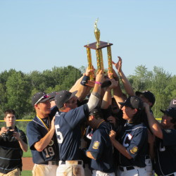 The Coffee News Comrades of Bangor hoist the championship trophy after rallying for seven runs in the eighth inning to overcome a four-run deficit to beat Morrill Post 35 of South Portland for the American Legion baseball state title at Wainright Recreation Complex in South Portland on Aug. 2, 2015.