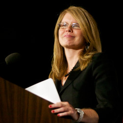 Mary Mayhew, commissioner of the Department of Health and Human Services, smiles as the crowd applauds in Portland on July 29, 2014, where she was honored by the conservative think tank Maine Heritage Policy Center.