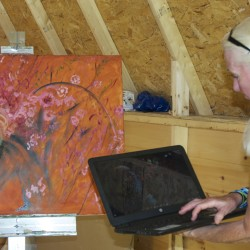 Artist Monica Brooke Taney consults a digital image of her model recently at her studio in Fort Kent. Taney said the digital age has made it much easier for artists to quickly record a subject or a scene with an electronic image for later inspiration in the studio.