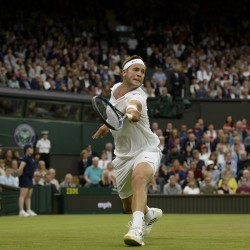 Great Britain's Marcus Willis returns a shot to Switzerland's Roger Federer during their Wimbledon singles match Wednesday at the All England Lawn Tennis and Croquet Club.