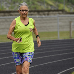 Rene Collins, 74, has been running for more than 30 years. She has run in 16 Boston Marathons and is training with her team for the third annual Down East Sunrise Trail Relay in July, a 102-mile, overnight relay race. Collins is one of the oldest members of her local running group called Maine Running Fossils. Collins was training at the track at the Brewer Community School on Tuesday morning.