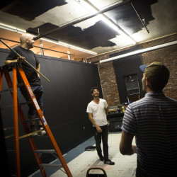 Three of four partners at Overlook, a new cooperative film production space on Brackett Street in Portland, work together late Wednesday night to get their studio and screening room ready for an open house on Friday. From left are, Jay Brown, Jeffrey Griecci and Alex Coppola.
