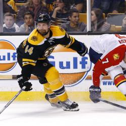 Boston Bruins defenseman Dennis Seidenberg (44) knocks the puck away from Florida Panthers defenseman Dmitry Kulikov at TD Garden in March.