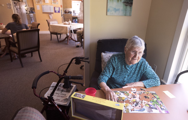 Islesboro native Marie Hall, a resident at Boardman Cottage, works on a puzzle Friday morning.
