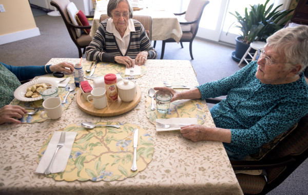 Boardman Cottage residents Marie Hall, right, and Florence Cross sit down for lunch Friday morning.