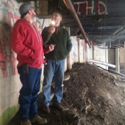 Skip Dodson from Circle D Spray Foam and Rollin Thurlow, chair of the theater's facilities committee, examine areas in need of additional insulation.