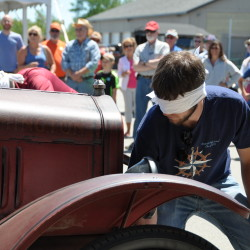 A blindfolded Model T cranking competition will be included in the upcoming All-American Auto Meet on June 18 and 19 at the Owls Head Transportation.