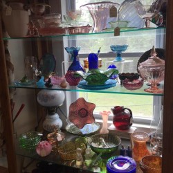Depression-era glass, which used to be a staple of the Hobby Horse Flea Market, can be seen on Thursday in Searsport. Items such as dish sets, cookie jars and knick-knacks used to be popular, but that has changed.