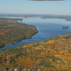 This file photo, taken above the village of Grand Lake Stream, shows some of the 21,000 acres east of West Grand Lake (on the right side of the photo) acquired by Downeast Lakes Land Trust.