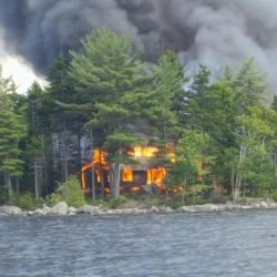 Fire destroys cottage on heart-shaped island; rain saves forest, firefighter says