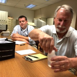 Plymouth-based Soil Preparation Inc. plant Manager John Barry (left) watches as company environmental consultant Ted Johnston demonstrates the n-butanol odor intensity scale the Maine Department of Environmental Protection will be using to determine if an odor is a nuisance. The plant takes septic waste and sludge for processing into organic non-food crop fertilizers.
