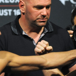 UFC president Dana White sets up a photo with two fighters during the weigh-ins at the Cross Insurance Center in Bangor on Aug. 15, 2014.