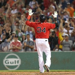 Boston Red Sox designated hitter David Ortiz celebrates after hitting a home run against the Los Angeles Angels during the fifth inning Friday night at Fenway Park in Boston.