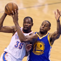 Oklahoma City Thunder forward Kevin Durant (35) drives to the basket as Golden State Warriors forward Andre Iguodala (9) defends during the second half in game four of the Western conference finals of the NBA Playoffs at Chesapeake Energy Arena.