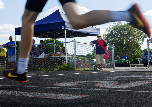 Mary Cady (center) watches runners compete in the 1,600-meter run during the Penobscot Valley Conference Freshman Championship Meet at Cameron Stadium in Bangor. Cady is a longtime USATF official and Penobscot Valley Conference track and field meet director who has been a steadying force in running meets and promoting local athletes for many years.