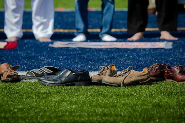 Shoes line the edge of the football field at Fitzpatrick Stadium in Portland on Wednesday morning while local Muslims prayed and celebrated Eid al-Fitr together.