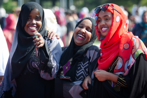 Three girls laugh while exiting Fitzpatrick Stadium in Portland on Wednesday after Eid al-Fitr prayers marking the end of Ramadan.