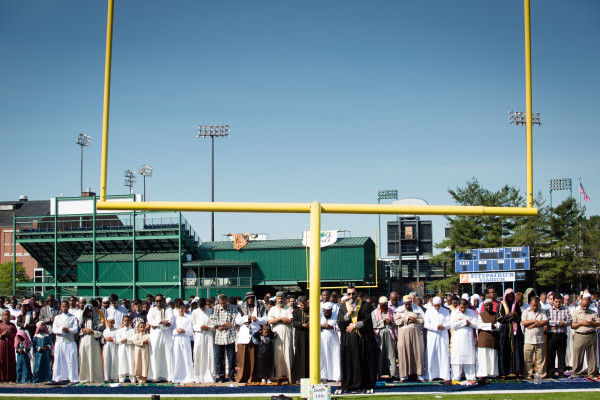 Imam Younus Alfayyadh leads local Muslims in Eid al-Fitr prayers near the goal posts at Fitzpatrick Stadium in Portland on Wednesday.