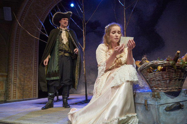 Cyrano de Bergerac, played by Christopher Holt, listens as Roxanne, portrayed by Marjolaine Whittlesey, reads a love letter she believes was written by Christian in Theater at Monmouth's production of &quotCyrano.&quot