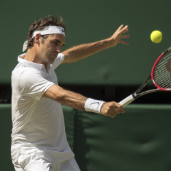 Roger Federer of Switzerland returns a shot to Marin Cilic of Croatia during the Wimbledon men's quarterfinals on Wednesday at the All England Club in London.