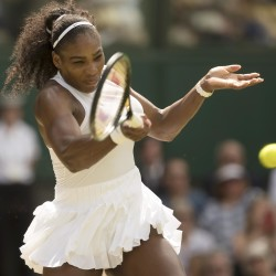 Serena Williams returns a shot to Elena Vesnina in their Wimbledon singles semifinal match Thursday in London.