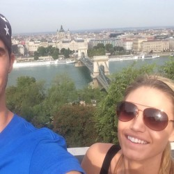 Troy Barnies (left) of Auburn and his fiancee, Abby Tardiff of Augusta, pose for a selfie overlooking the Danube River and Budapest, Hungary. Barnies, a former Edward Little High School and University of Maine basketball standout, is gearing up for his sixth season of pro ball in Europe.
