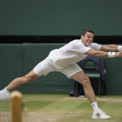 Milos Raonic reaches to return a shot to Roger Federer during their Wimbledon singles semifinal match Friday in London.