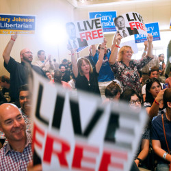 """Supporters of U.S. Libertarian Party presidential candidate Gary Johnson cheer during the """"Politicon"""" convention in Pasadena, California, June 25, 2016."""