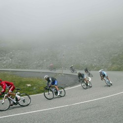 The pack of riders cycles in the fog during the 10th stage of the Tour de France Tuesday from Escaldes-Engordany, Andorra to Revel, France.
