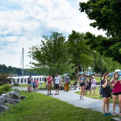 Pokemon Go players flock to the Bangor Waterfront on Tuesday afternoon to take advantage of lures placed simultaneously on three Pokestops in the area.