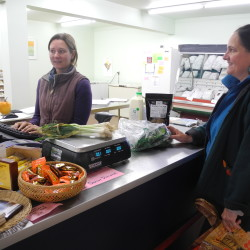 """Lauren Errickson of Brooks rings up some produce Friday for Meredith Toumayan of Jackson at the new Marsh River Co-op. """"We opened the store without any kind of loans or investment,"""" Errickson, a co-op board member said. """"It was a few years of planning, discussion and meetings. It's wonderful to see it come into being."""""""