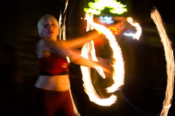 "Fiery hoop spinner Alexis Powers performs in Post Office Park in Portland in July. ""&quotWhen I began practicing, I never could have imagined performing, being an insured or sponsored performer, being involved with professional troupes. ... I just kept at it because I enjoyed it and it was fun,""&quot Powers said."