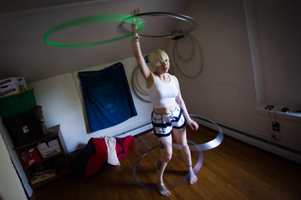 Keeping five hoops spinning simultaneously, Alexis Powers practices in a special room in her Augusta home. Powers has been serious about performing since 2009 after studying visual arts at the Maine College of Art in Portland.