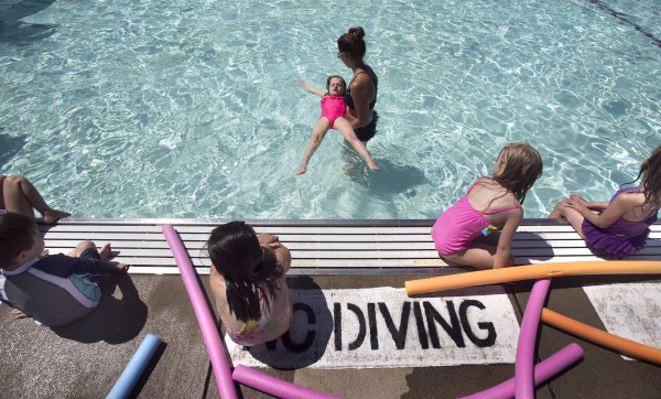 Swimming instructor Abigail Hartsgrove (center) assits Acadia Brace (third from left), 5, during swimmig lessons on July 11 at the Beth Pancoe Aquatic Center in Bangor.