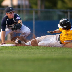 Bronco-Hermon's Mark Mailloux (right) safely slides to third past Sebasticook Valley's Ben Southwick during their District 3 Senior League all-star baseball tournament game at Mansfield Stadium in Bangor Friday.
