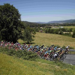 The pack of riders cycles during the 15th stage of the Tour de France  Sunday from Bourg-en-Bresse to Culoz, France.