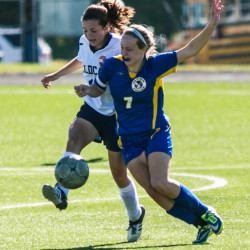 Presque Isle striker Madison Michaud (left) wins a ball at midfield against Hermon defender Morgan Buck during a game on Sept. 29, 2015 at the Johnson Athletic Complex in Presque Isle.
