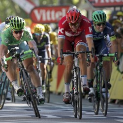 Peter Sagan of Slovakia (left) beats Alexander Kristoff of Norway (right) at the finish line during the 16th stage of the Tour de France Monday from Moirans-en-Montagen, France to Berne, Switzerland.