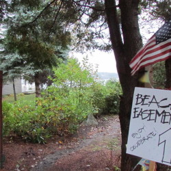 A handwritten sign at the end of Cedar Beach Road on Bailey Island in Harpswell welcomes the public to the beach on Oct. 10, 2014.