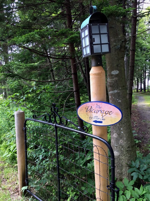 A small sign points the way to The Vicarage by the Sea, a home in South Harpswell for people with dementia.